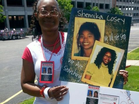 Paula Posey holds up a picture of her daughter, Shemika Cosey, who has been missing since 2008. Image source: ABC news